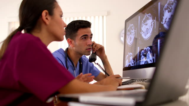 Mexican doctors analyzing brain x-rays video
