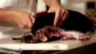 Mexican fish market cutting fillet HD video