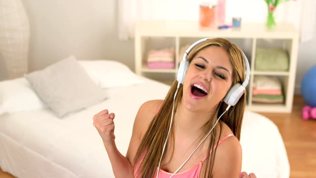 Mexican teenager listening to music video