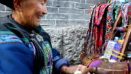 Miao ethnic old lady traditional weaving,medium shot video