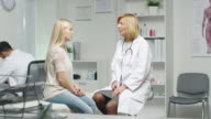 Mid Adult Female Doctor Consults Young Woman about Her Health. video