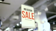mid season sale sign in store video
