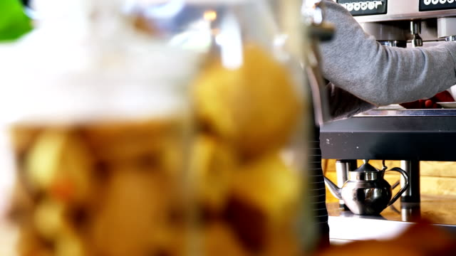 Mid section of waiter making cup of coffee video