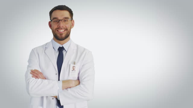 Mid Shot of a Scientist Wearing Glasses Making I have an Idea/ Eureka Gesture. Shot with White Background. video