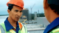 Middle Age Male Engineers Discussing the Project at the Construction Site video