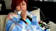 Middle age woman sick with flu sitting at home video