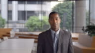 Middle aged black businessman walking into focal plane video