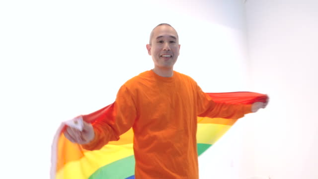 Middle aged male spinning in circle with gay pride flag video