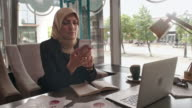 Middle Eastern business lady making phone call in cafe video