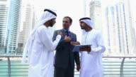 Middle eastern businessmen discuss with western man video