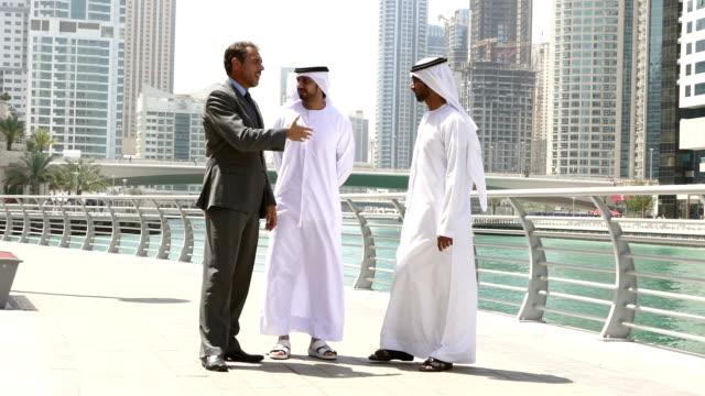 Middle eastern businessmen meeting western man - Stock video video