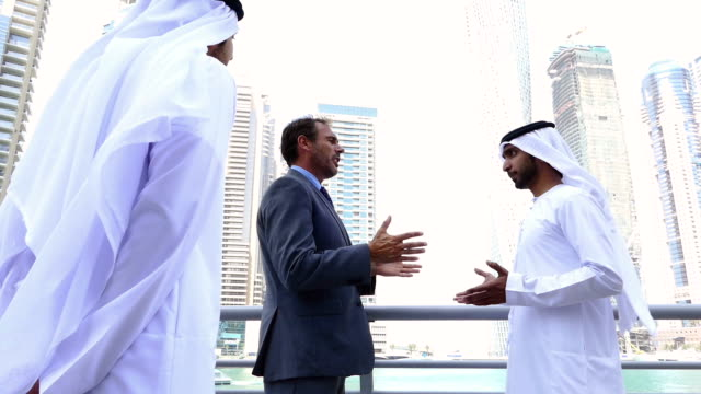 Middle eastern businessmen meeting western man video