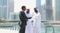 Middle eastern businessmen with western man outdoor video