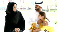 Middle Eastern family with thear children in the park video