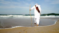 Middle Eastern Man Walking toward Sea Religious Concept video