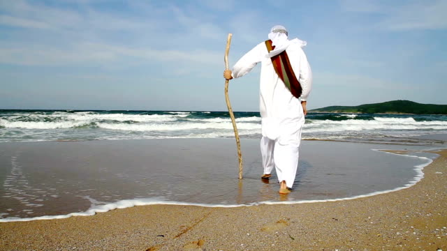 Middle Eastern Man Walking toward Sea Religious Concept video