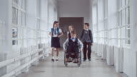 Middle School Student in Wheelchair in Hallway video