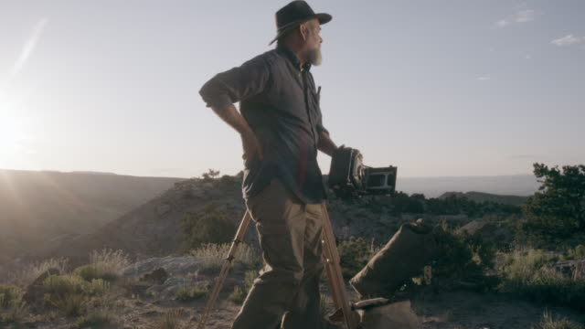 Middle-Aged Caucasian Male Outdoor Photographer Stands Up video