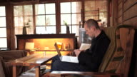 Middle-aged man of whites in the work at a cafe video