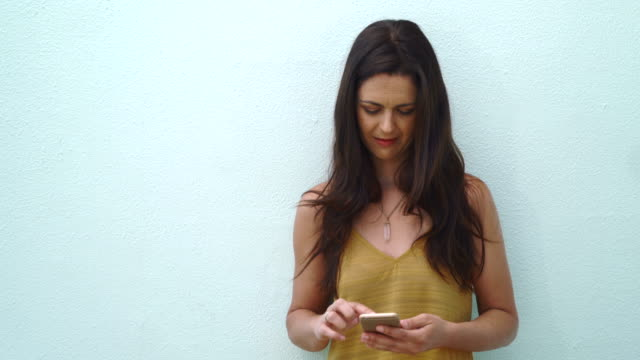 Middle-aged woman using the smart phone video