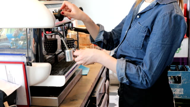 Midsection Of Female Barista Preparing Coffee video