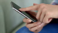 Midsection of woman using smart phone at home video