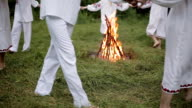 Midsummer. Young people in Slavic clothes revolve around a fire in the Midsummer. . video