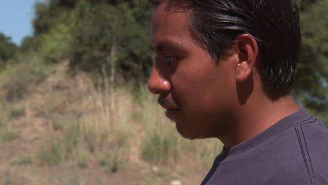 Migrant Worker Looking Down video
