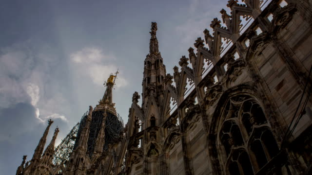 Milan, Italy,  Duomo cathedral, architectural detail two time lapse shots video