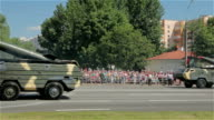 Military cars with a missiles go on the street video