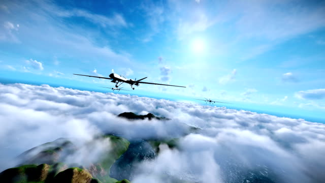 Military drones formation launching missiles, cruising above clouds, ocean and mountain peaks video