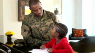 Military Father Helps Daughter with Homework video