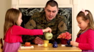 Military Father Playing with His Young Daughters - CU video