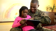 Military Father Plays on Digital Tablet with Daughter video