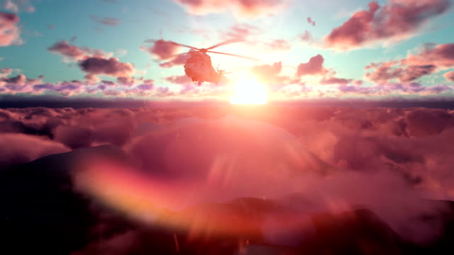Military Helicopter above clouds at sunset video