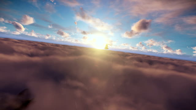 Military helicopter above sunset clouds video