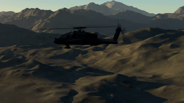 Military Helicopter Flying Over The Mountains video