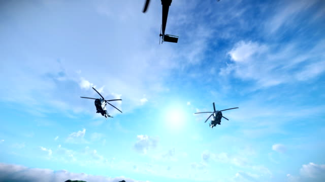 Military helicopter formation flying above clouds video