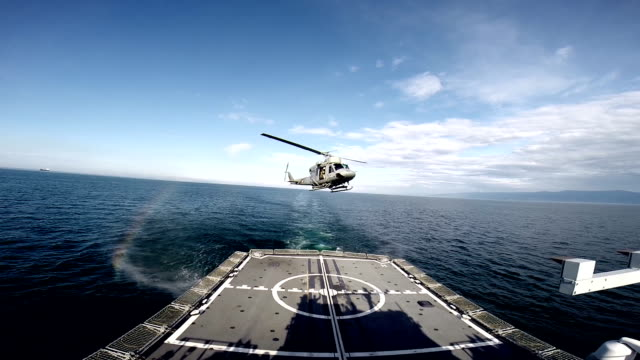 AB-212 ASW military helicopter lands on the deck of a battleship video
