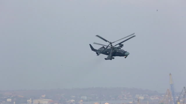 military helicopter patrols over the city video