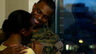 Military Husband and Wife Embrace by the Window video