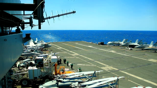 Military jet landing on  Aircraft Carrier. video