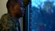 Military Man Gazes out the Window video