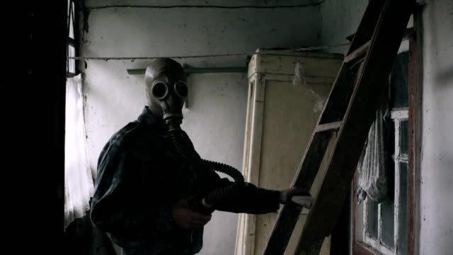 Military man in a gas mask video