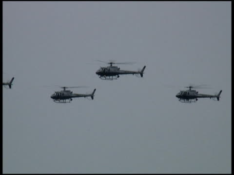 Military, Police, Security Helicopters Flying in Formation - Past Trees video