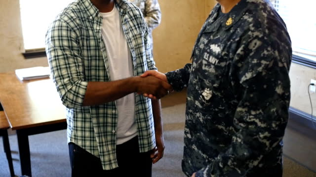 Military recruiter talking with young African American man video