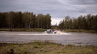 Military speedboat with special forces moving by the river and turns sharply video