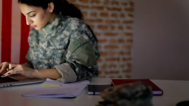 Military woman working on laptop video