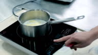 Milk and butter are heated in a saucepan video