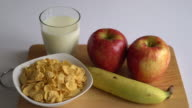 milk, apple, banana and cornflakes for breakfast video